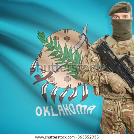 Soldier with machine gun and USA state flag on background series - Oklahoma - stock photo