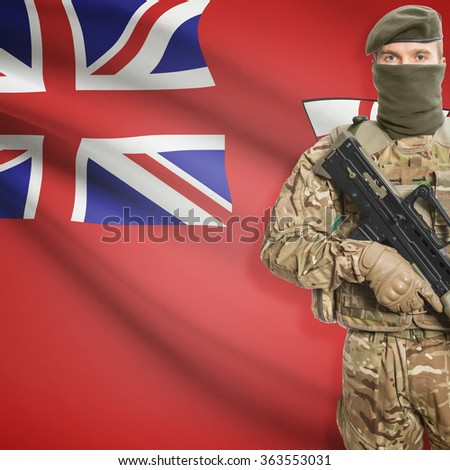 Soldier with machine-gun in hands and Canadian province flag on background series - Ontario