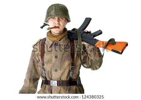 Soldier with machine gun smoking a cigar isolated on white background - stock photo