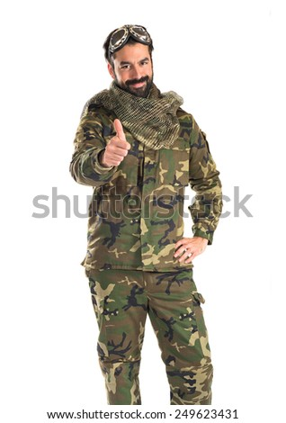 Soldier with pilot hat - stock photo
