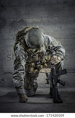 Soldier with rifle and helmet  - stock photo