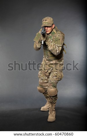 Soldier with rifle on a black background - stock photo