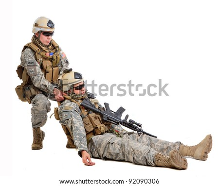 Soldier with rifle on a white background - stock photo