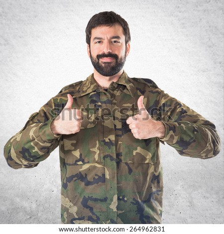 Soldier with thumb up  - stock photo