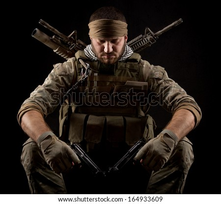 Soldier with two guns - stock photo