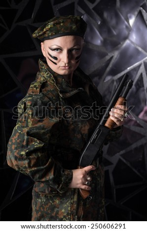 Soldier woman in beret - stock photo