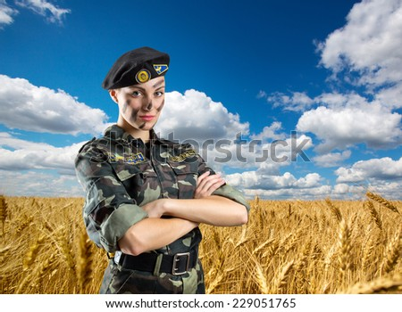 Soldier woman in military uniform - stock photo