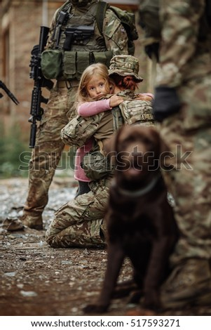 Soldiers and small girl  on battlefield background. Military and rescue operation concept.