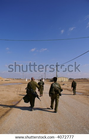 Soldiers exercise - walking in uniform with weapon - stock photo