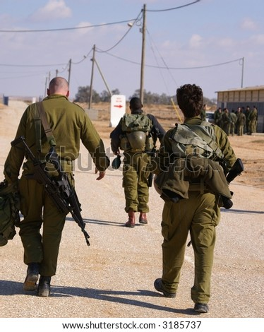Soldiers exercise - walking in uniform wiyh weapon - stock photo