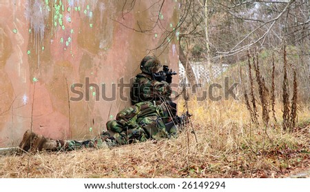 Soldiers game on military training ground ( batlle camp ). Action. Operation. - stock photo