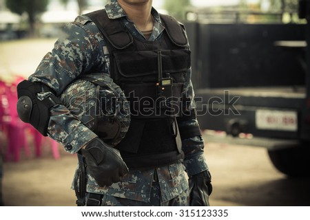 Soldiers , guarded , military equipment , military combat . - stock photo