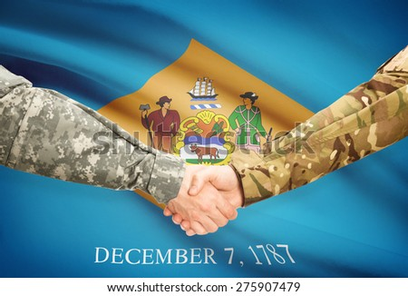 Soldiers handshake and US state flag - Delaware - stock photo
