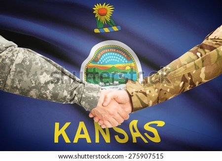 Soldiers handshake and US state flag - Kansas - stock photo