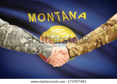 Soldiers handshake and US state flag - Montana - stock photo