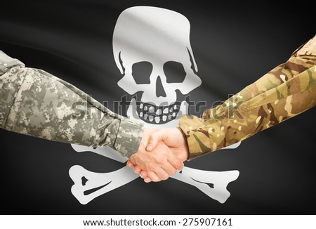 Soldiers handshake with flag on background - Jolly Roger - stock photo
