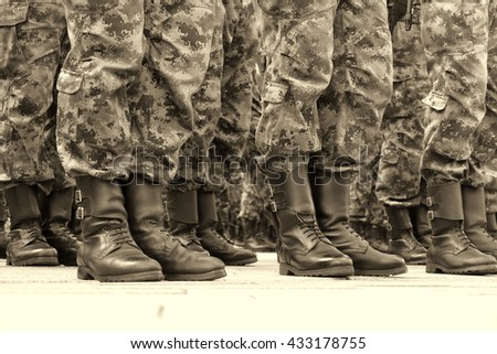 Soldiers in a row ;  lines  of commando soldiers in camouflage uniforms
