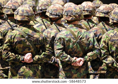 Soldiers in camouflage - stock photo