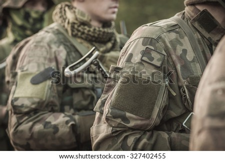 Soldiers in military uniform, army special forces - stock photo