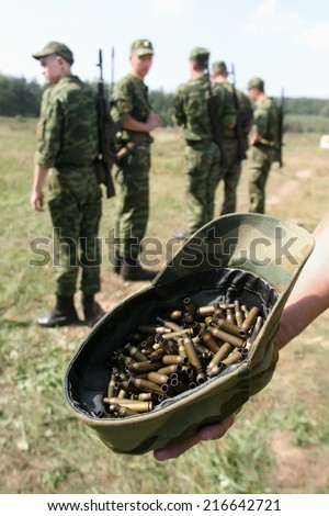 Soldiers in uniform with rifles standing isolated - stock photo