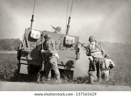 Soldiers in World War II era battle