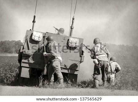 Soldiers in World War II era battle - stock photo