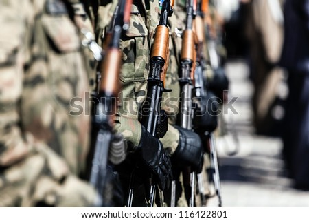 Soldiers march in formation, man and weapon marching in a row - stock photo