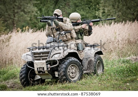 Soldiers on all terrain vehicle - fast response squad