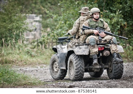 Soldiers on off road vehicle - fast response squad
