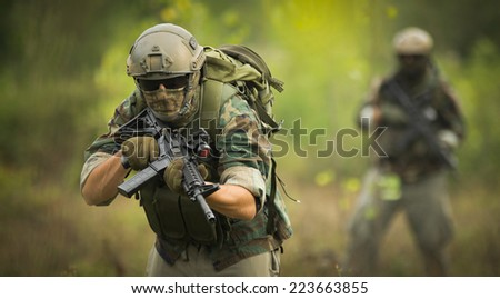 Soldiers on patrol - stock photo