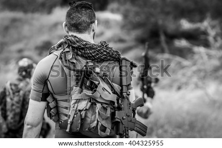 Soldiers on patrol during a military simulation Airsoft training game - stock photo