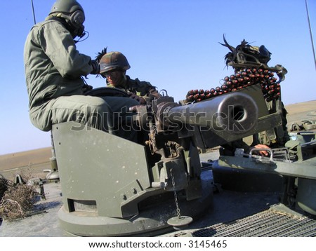 Soldiers on tank. Army - stock photo