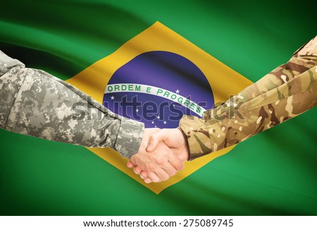 Soldiers shaking hands with flag on background - Brazil - stock photo