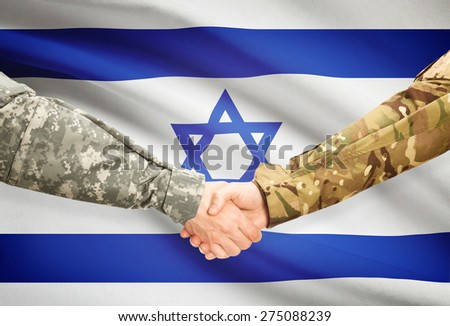 Soldiers shaking hands with flag on background - Israel - stock photo