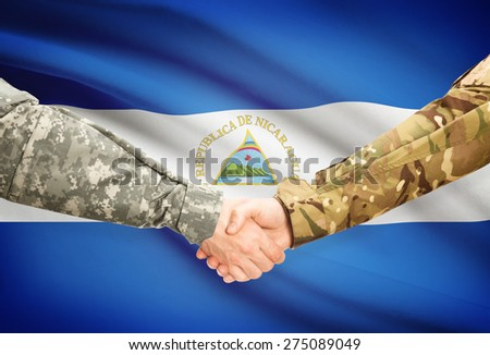 Soldiers shaking hands with flag on background - Nicaragua - stock photo