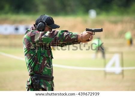 Soldiers were shooting at a target. - stock photo
