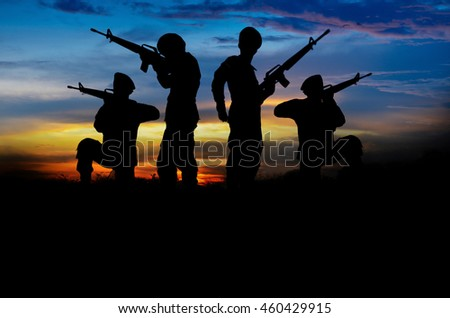 Soldiers with guns silhouette