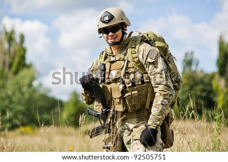 soldiers with weapons posing on rest - stock photo