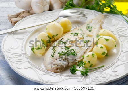 sole fish with potatoes - stock photo