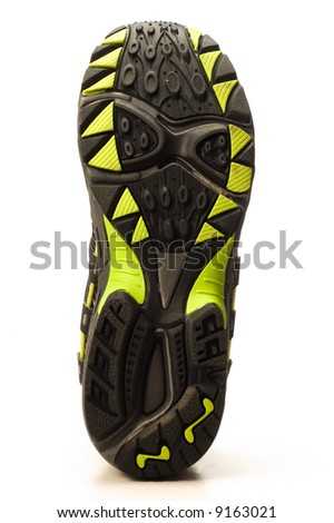 sole of running shoe on white background - stock photo