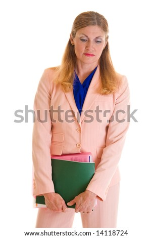 Solemn, beautiful, middle-aged blonde executive business woman in a pink business suit. - stock photo