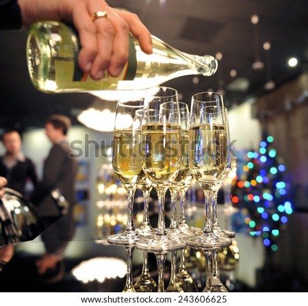 Solemn spill champagne on New Year's Eve - stock photo