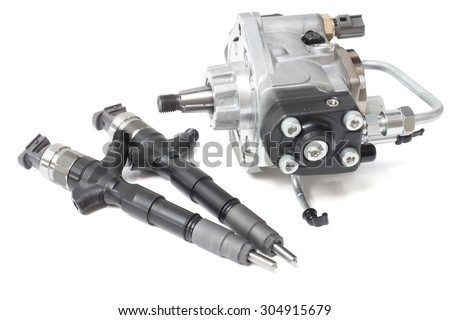 solenoid injectors for diesel fuel on a white background - stock photo