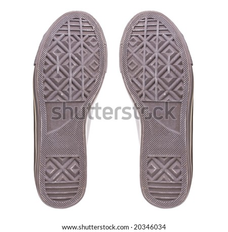 Soles of classic sneakers isolated on white