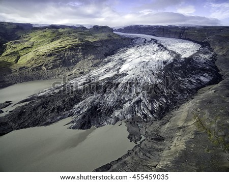 Solheimajokull outlet glacier and the glacial lagoon in front of it shot in summer with a drone - stock photo
