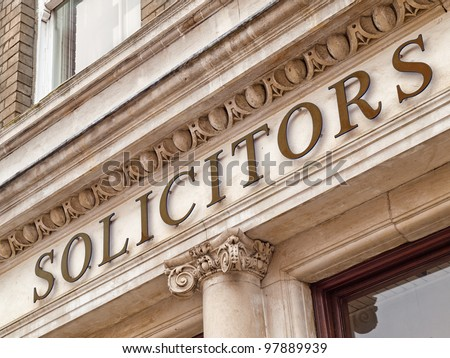 Solicitors sign on a office building - stock photo