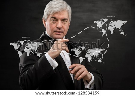 Solid business man working with virtual interface - building international business - stock photo