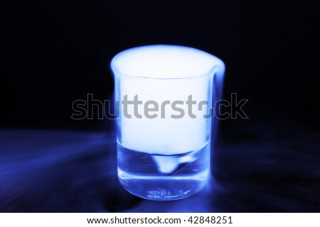 Solid carbon dioxide producing blue vapors - stock photo