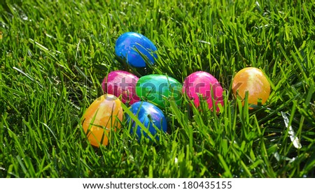 Solid color eggs on grass/Easter Egg Time/Multicolor eggs are lying on grass