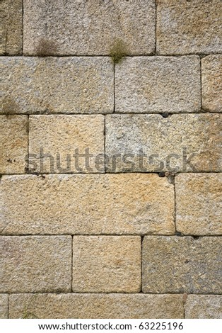 Solid old stone wall, made of large blocks of basalt rock, at the Douro valley, home of the port wine region, Portugal - stock photo
